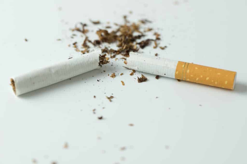 quit smoking concept by breaking the cigarette PQ8B6Z4